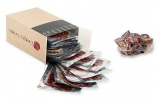 Open box of D.O. Huelva Summum Jabugo Bellota Ham - Sliced, and the cut bone